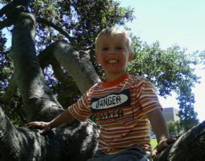 Little Boy in Tree - Time is fleeting